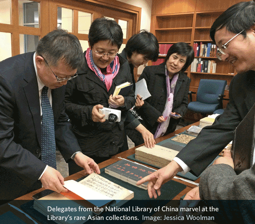 people looking at rare books