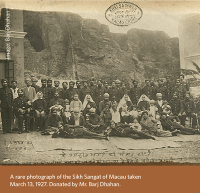 men seated for photo